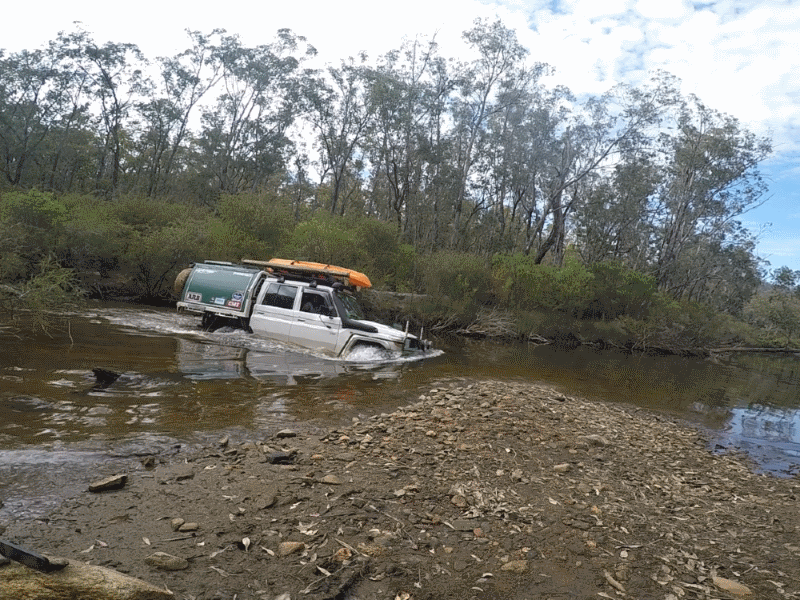 Toyota Landcruiser Dual Cab Workmate in a water crossing.