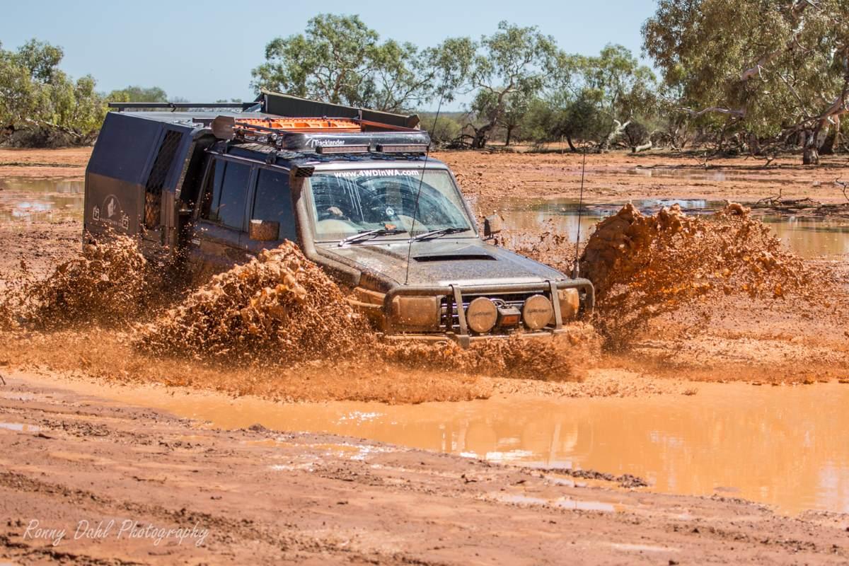 79 Series Land Cruiser in red mud.