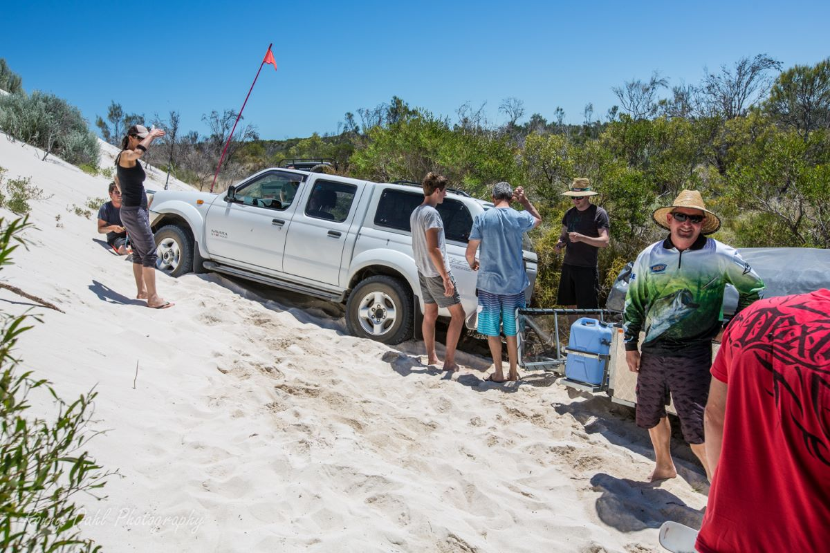 4wd with camper trailer stuck in a sand dune.
