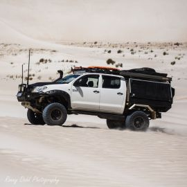 A Toyota Hilux SR in the sand dunes at Lancelin, Western Australia.