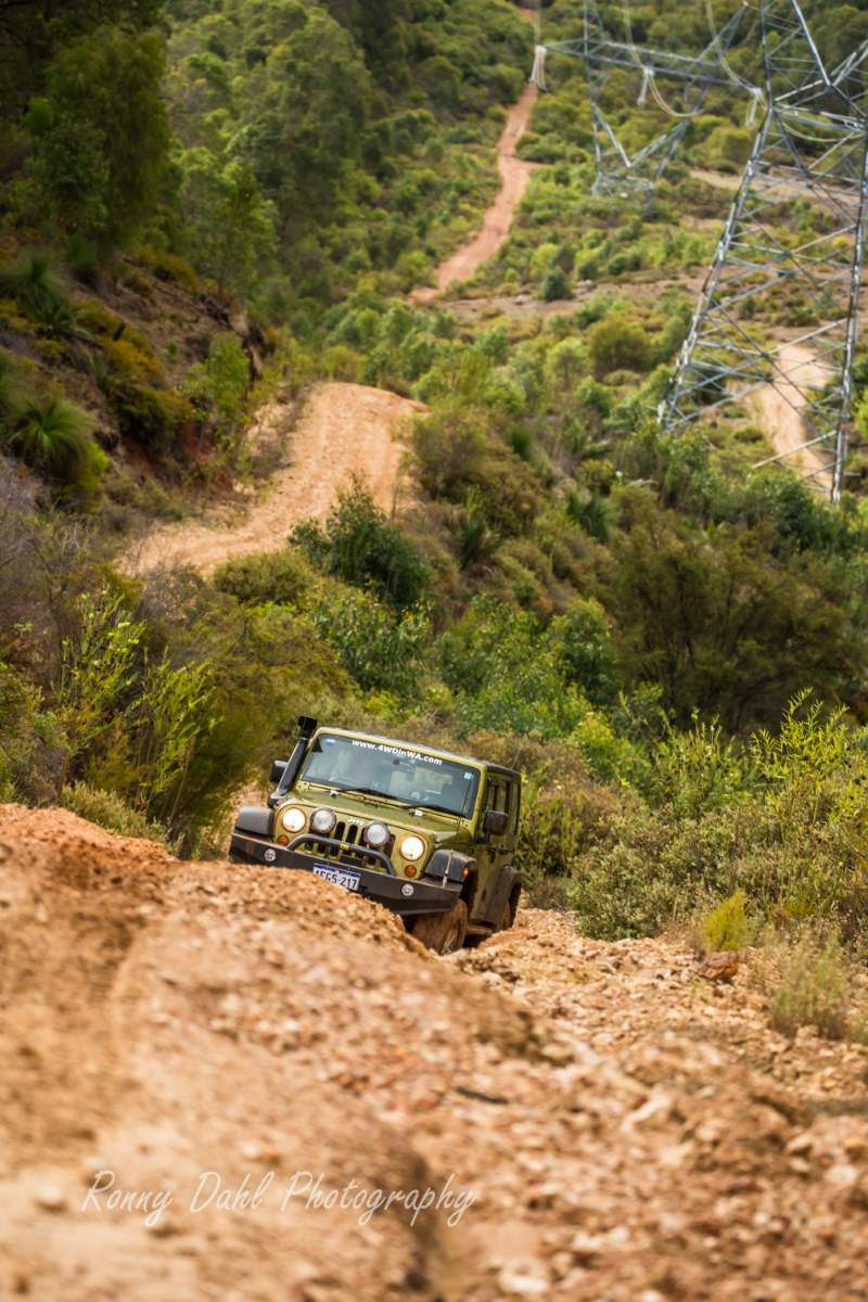 The Jeep Wrangler in 4 wheel drive terrain.