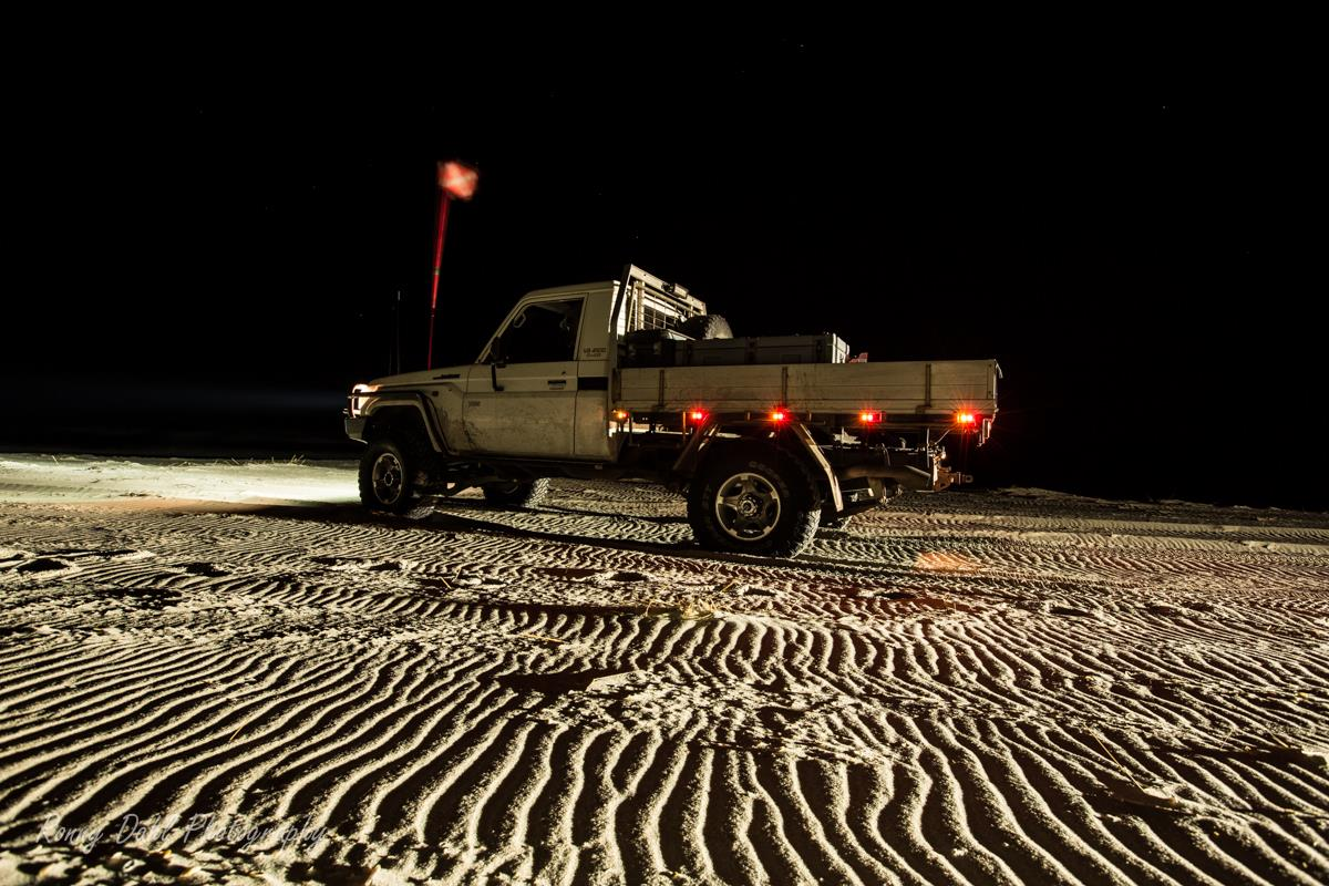 Single cab 79 series Landcruiser in the night.