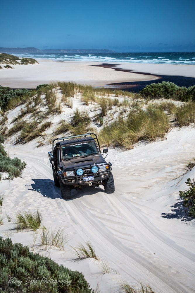 The 79 series Land Cruiser on a sand track.