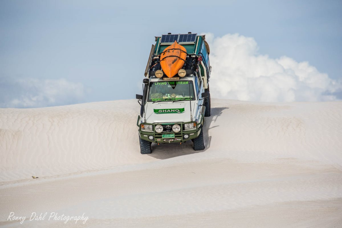 79 Series Landcruiser in sand dunes at Wedge Island, Western Australia.