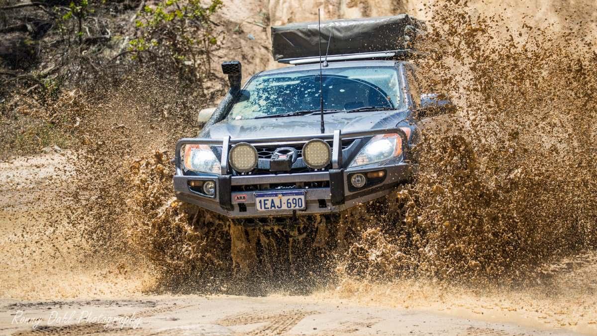 Mazda BT 50 in muddy water.
