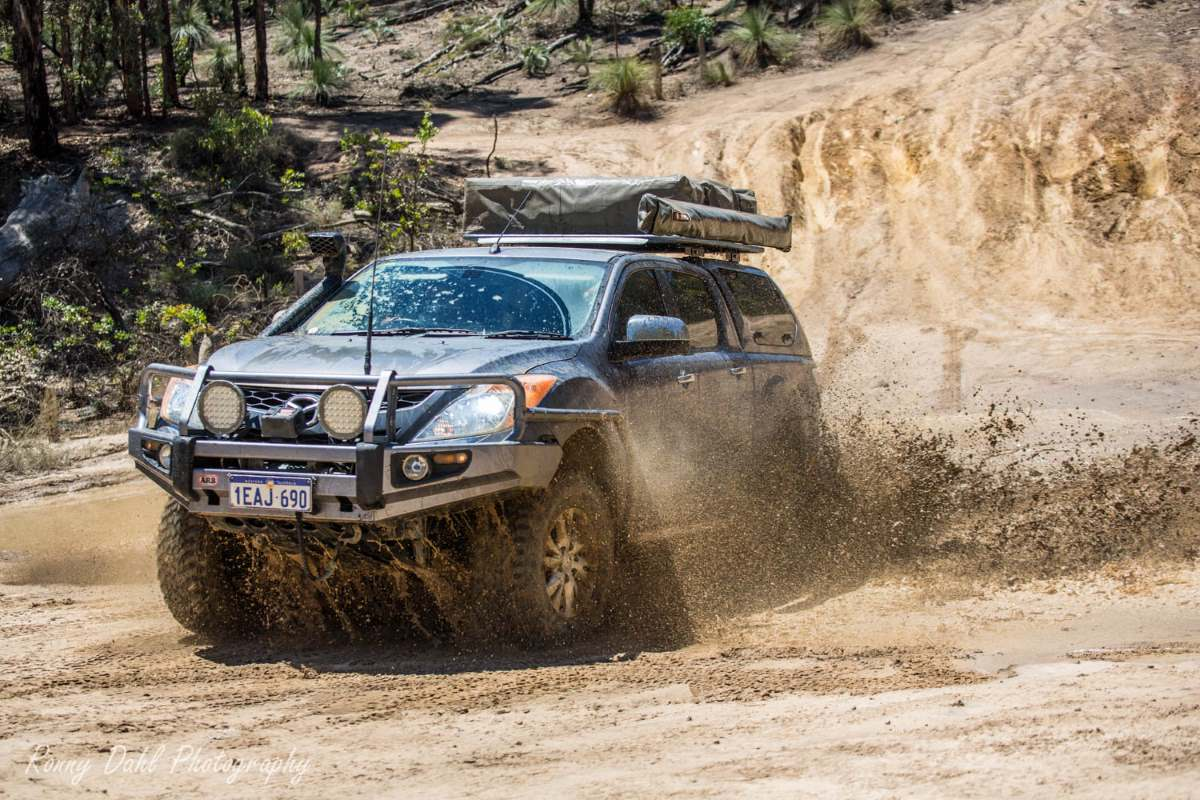 Mazda BT 50 in muddy water.