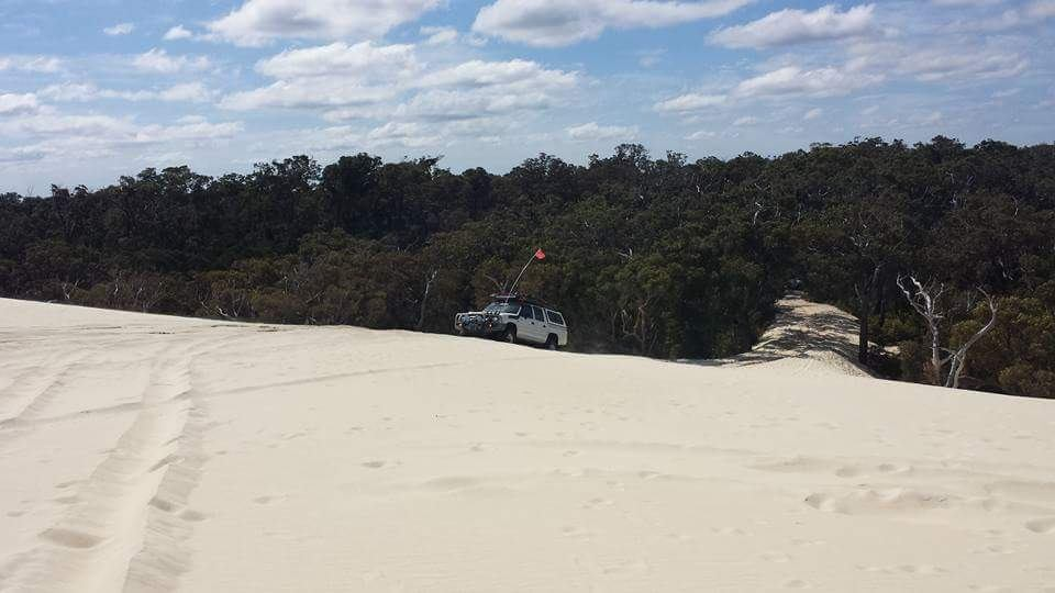 Modified Toyota Hilux, on sand dunes.