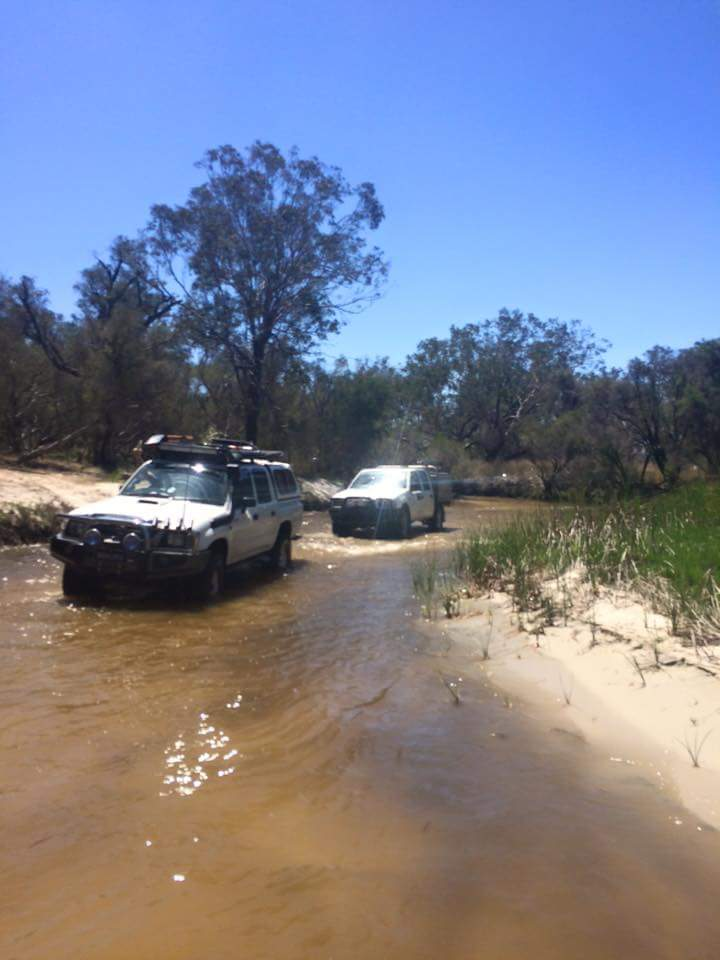 Toyota Hilux in water crossing.