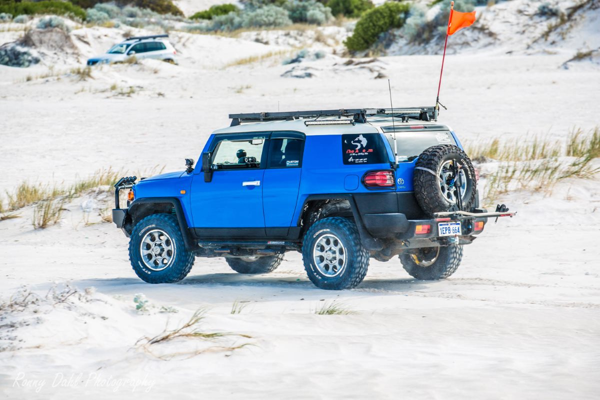 Toyota FJ Cruiser in the sand dunes, Western Australia..
