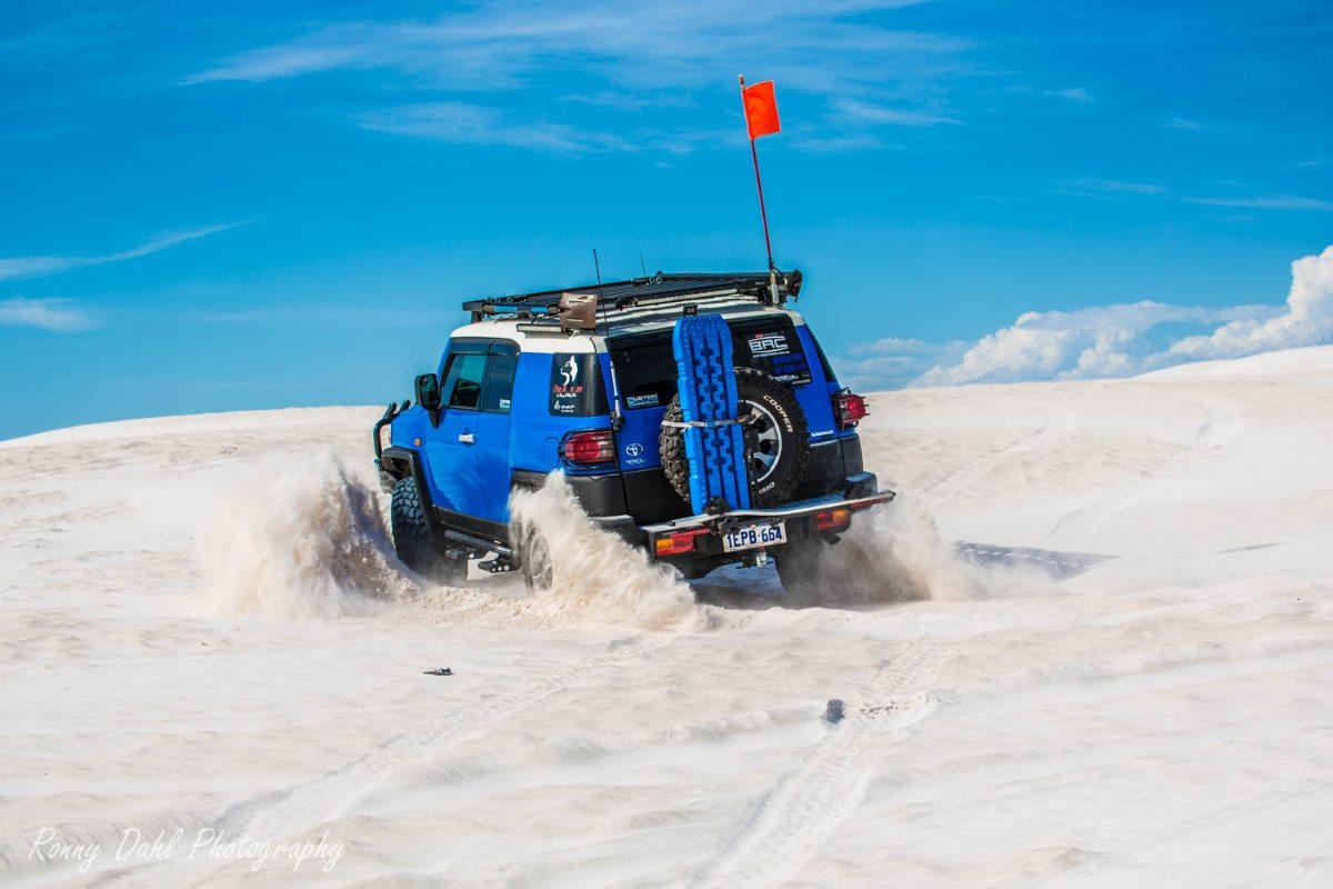 Toyota FJ Cruiser in the sand dunes, Western Australia..