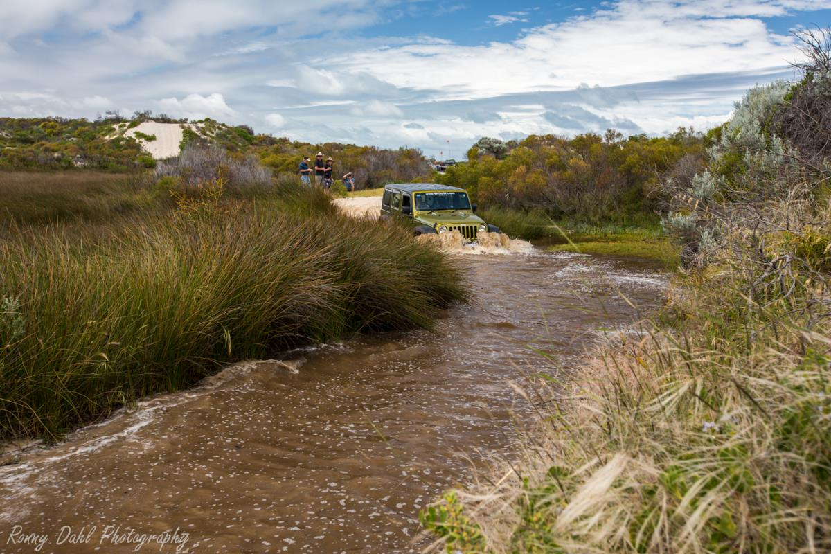 Jeep Wrangler doing a water crossing.