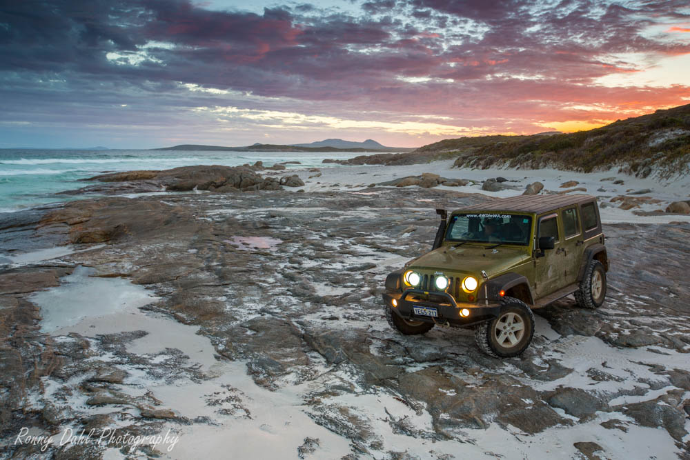 Jeep Wrangler JKU on the beach.