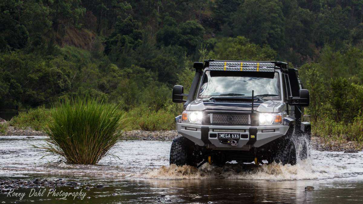 MEGA TOURER 6X6 in a water crossing.