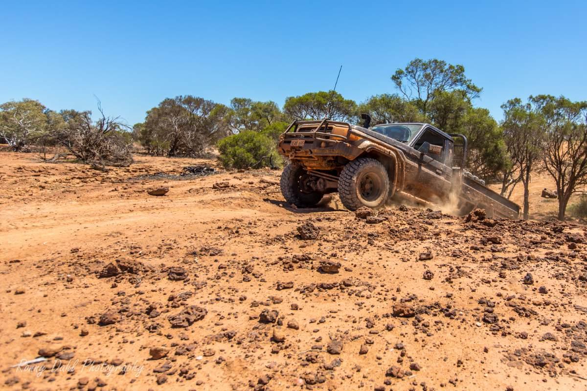 Toyota Landcruiser climbing a hill.