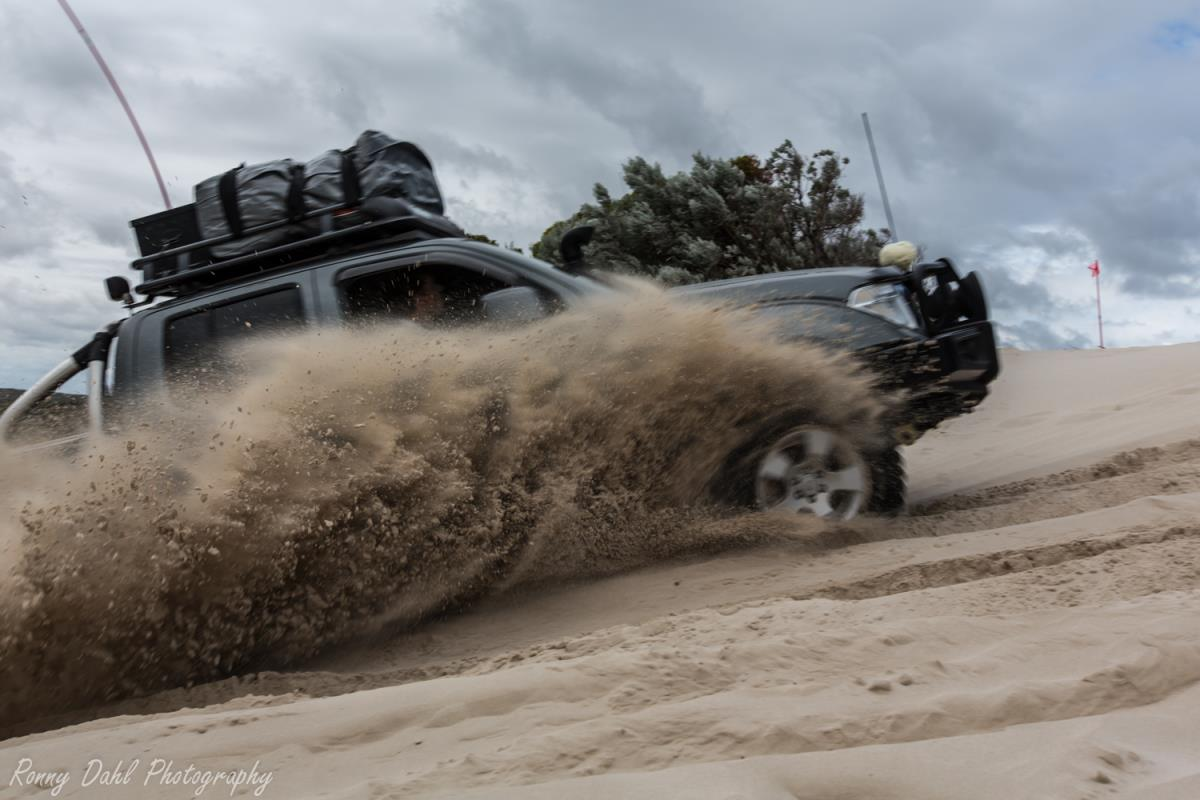 A Nissan Navara doing sand spray at Cervantes sand dunes.