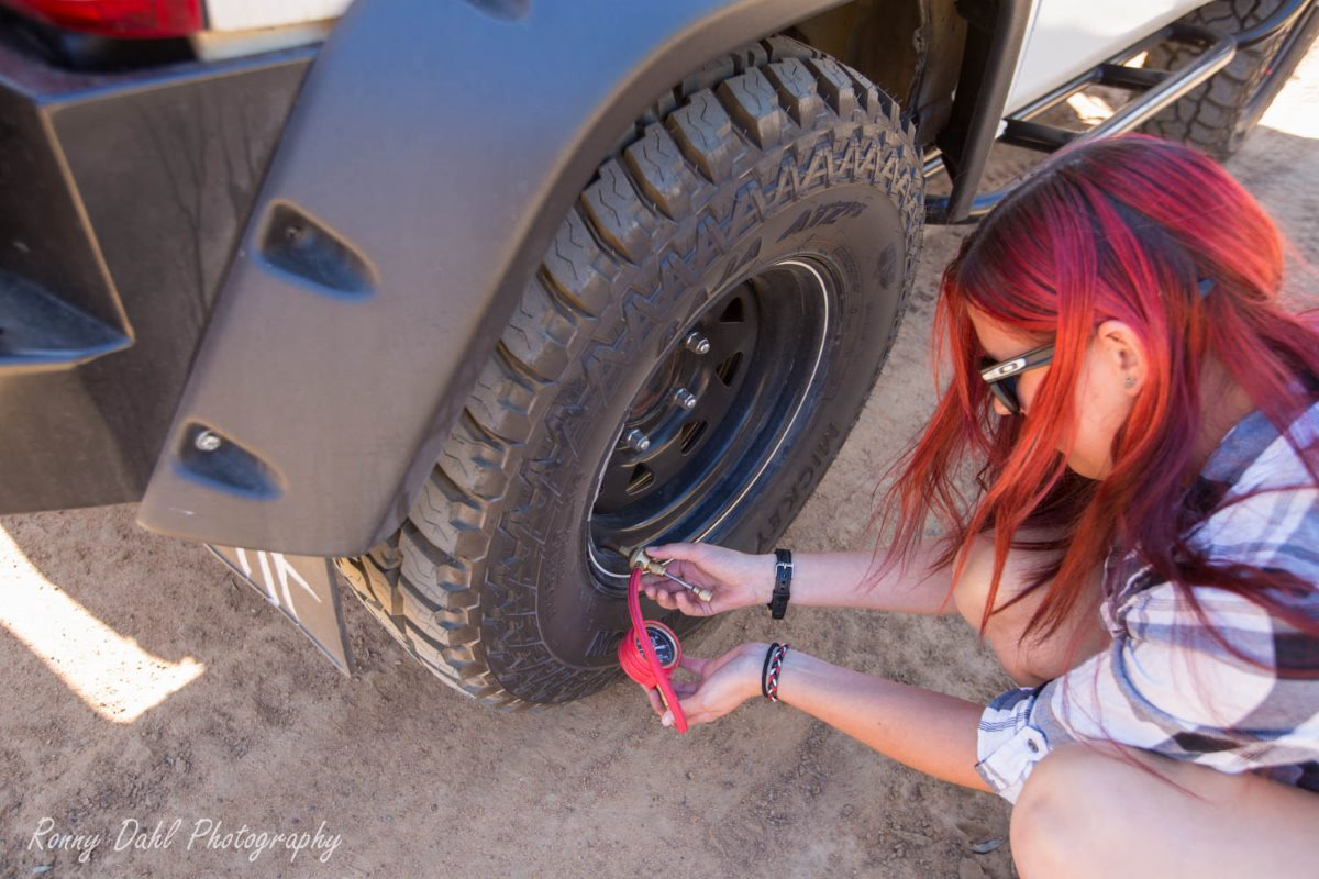 Siani deflating her tires before hitting the track.