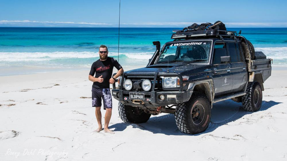 Ronny with his 79 Series Landcruiser on the beach.