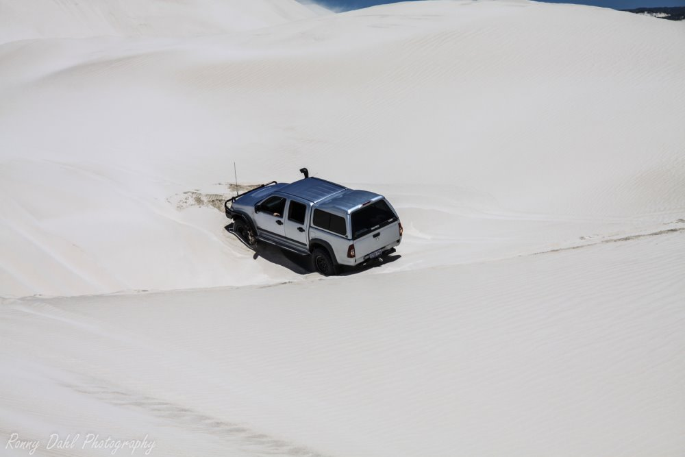 Toyota Hilux bogged in sand.