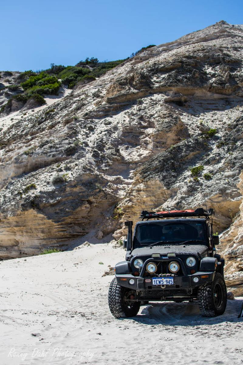 A Jeep JK Wrangler on the beach in Western Australia.