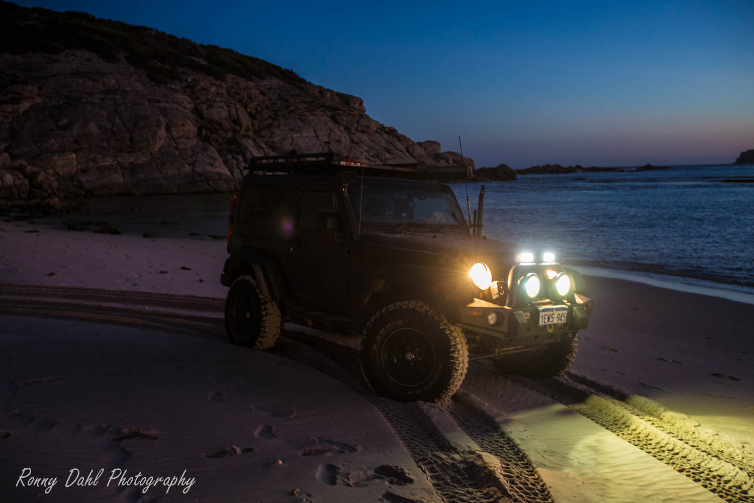 A Jeep JK Wrangler in the sunset.