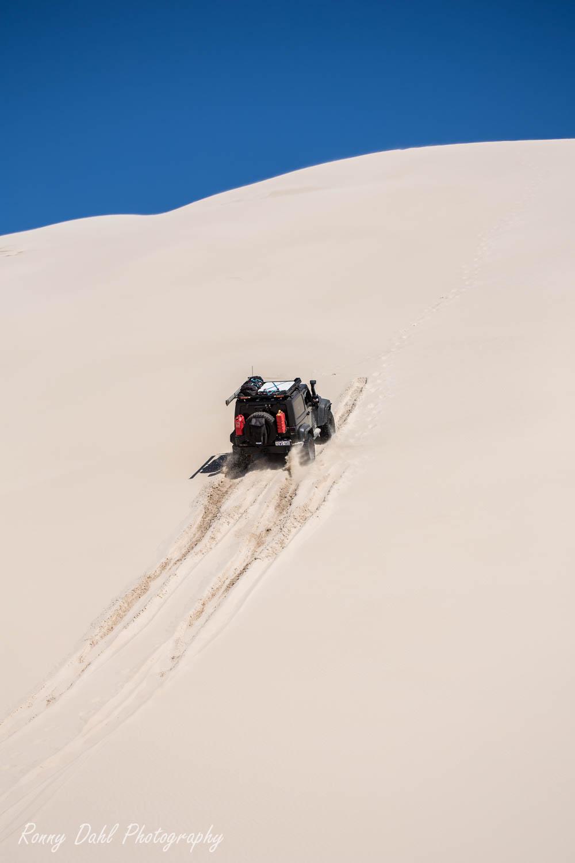 A Jeep JK Wrangler on a sand dune in Western Australia.