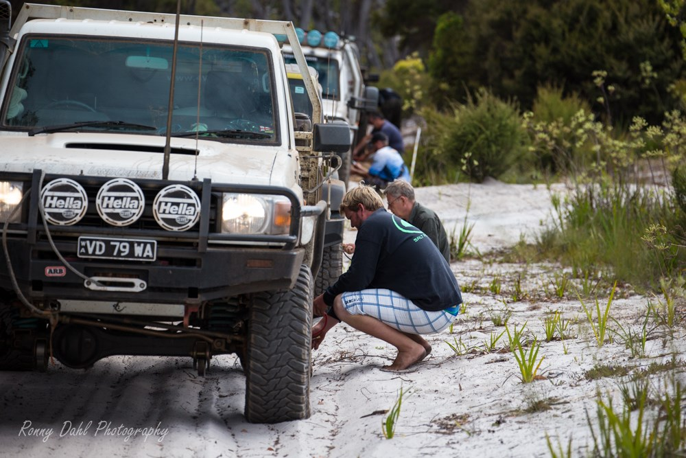 Deflating tires before going on the sand dunes.