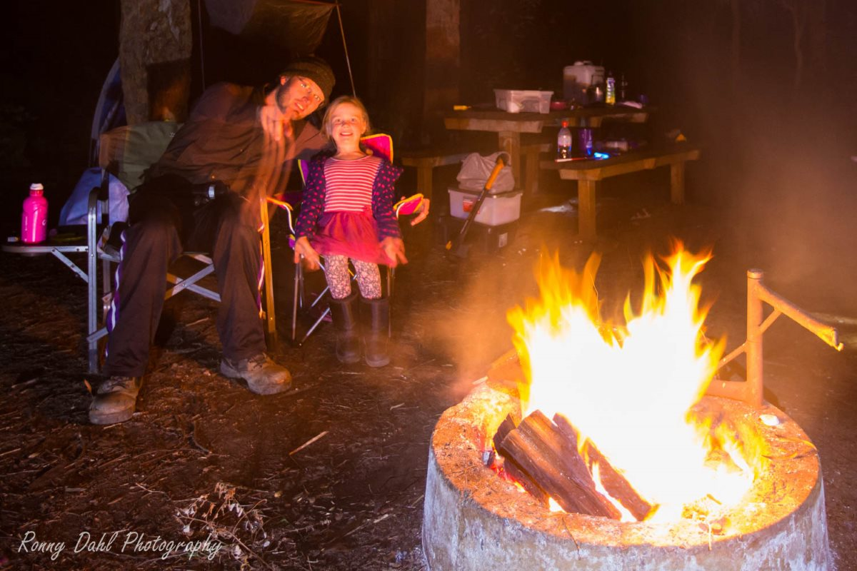 Kids around camp fire.