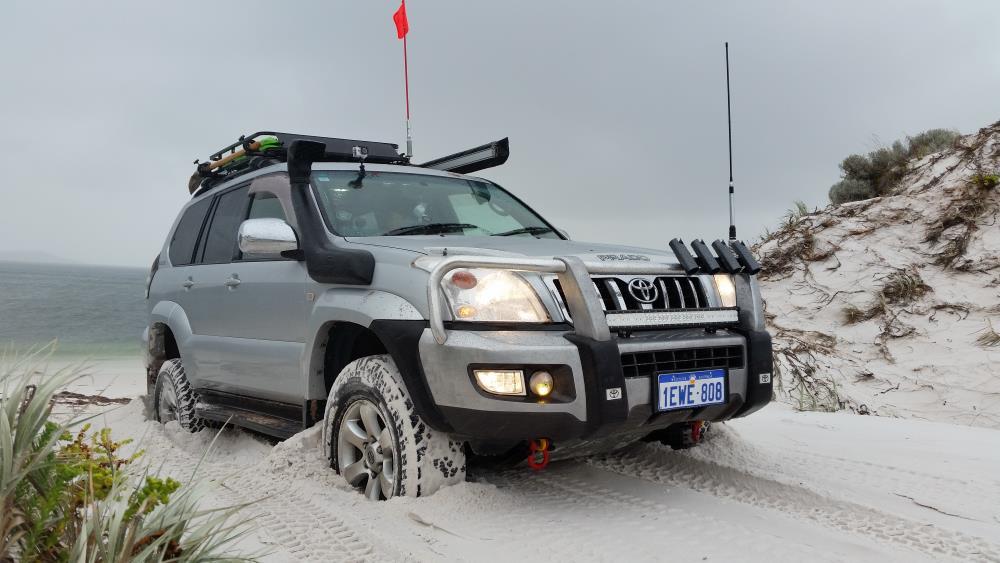 Toyota Prado 120 Grande, stuck in the sand.