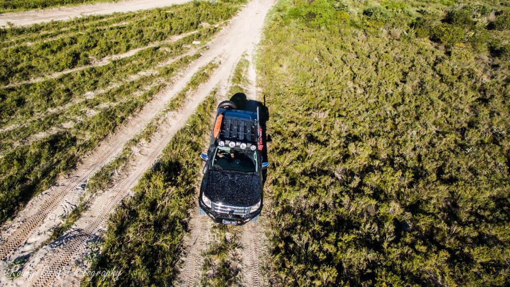 Ford Ranger XLT on a sand track.
