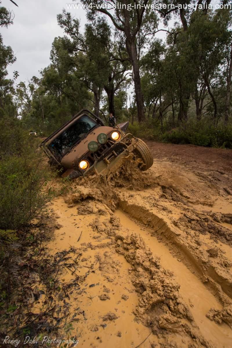Jeep Wrangler in mud.