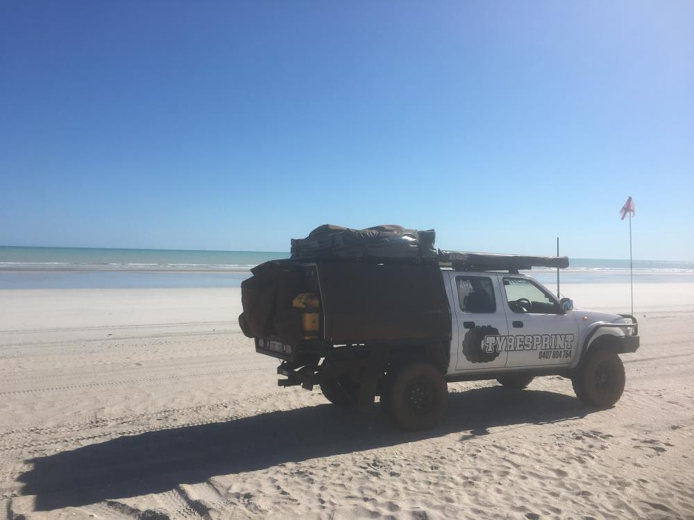 Nissan Navara D22, modified, on the beach.