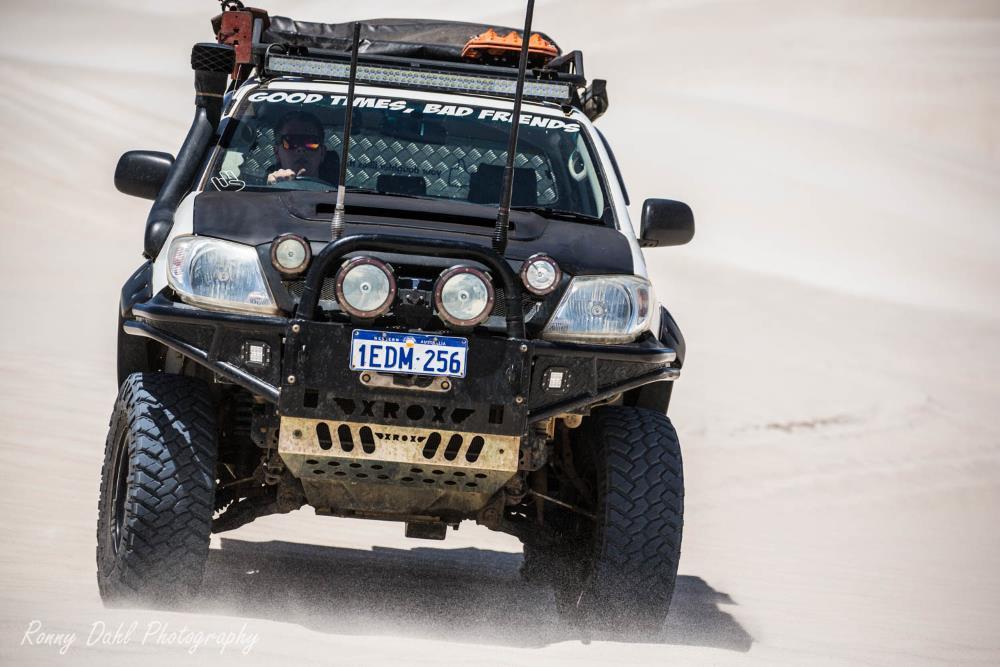 A Toyota Hilux SR in the sand dunes at Lancelin, Western Australia.
