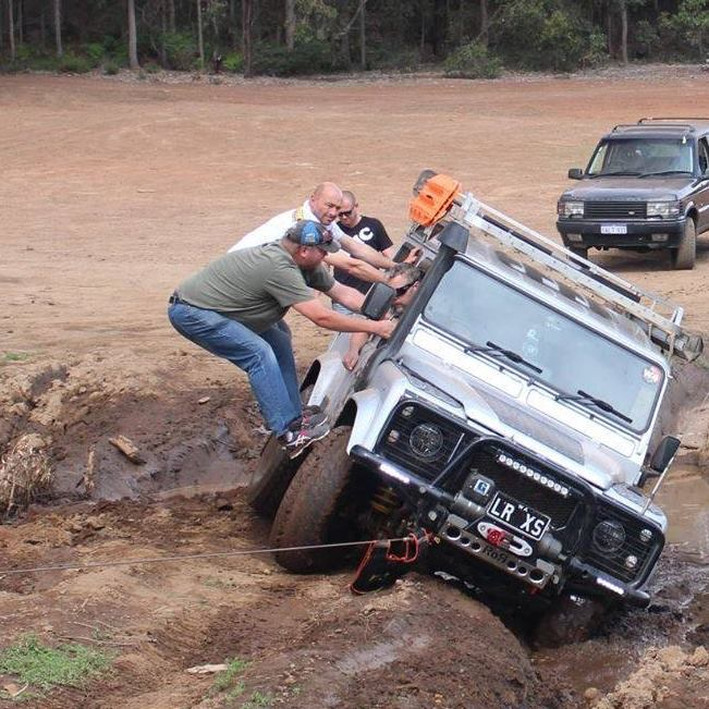 Land Rover Defender 90, nearly rolling.