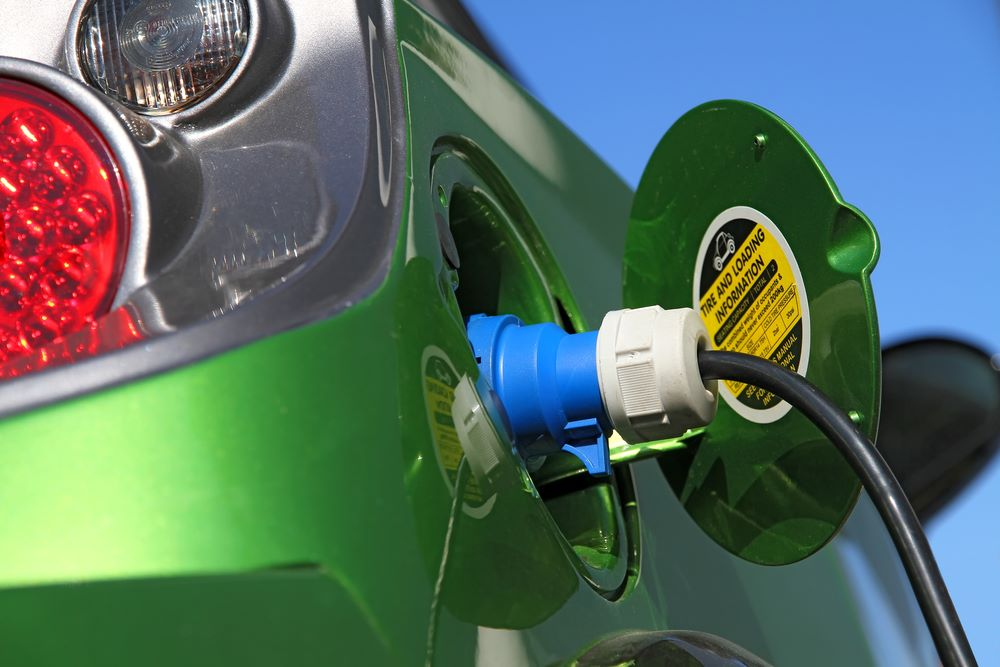 Electric car refuels with power.