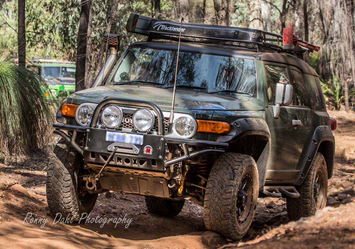 FJ Cruiser with front bash plate, rock sliders and steel bull bar bull bar allowing for an increased approach angle.