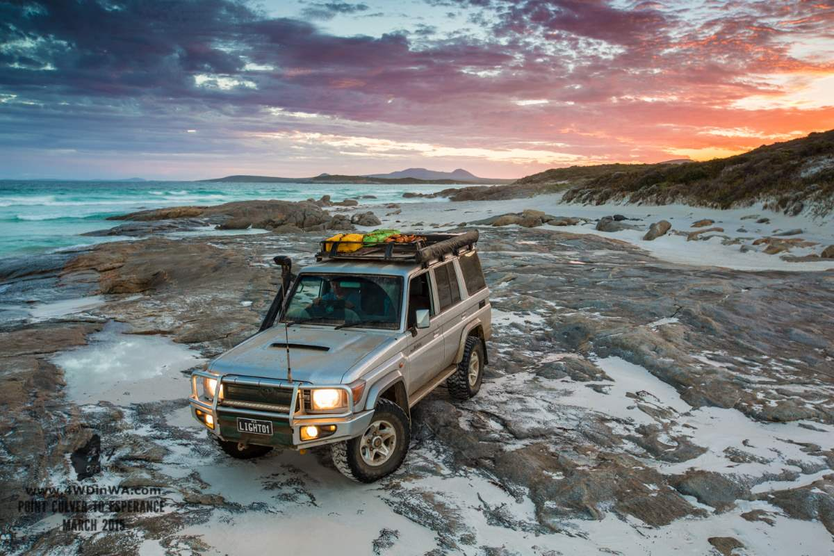 Toyota Landcruiser on the beach at night.