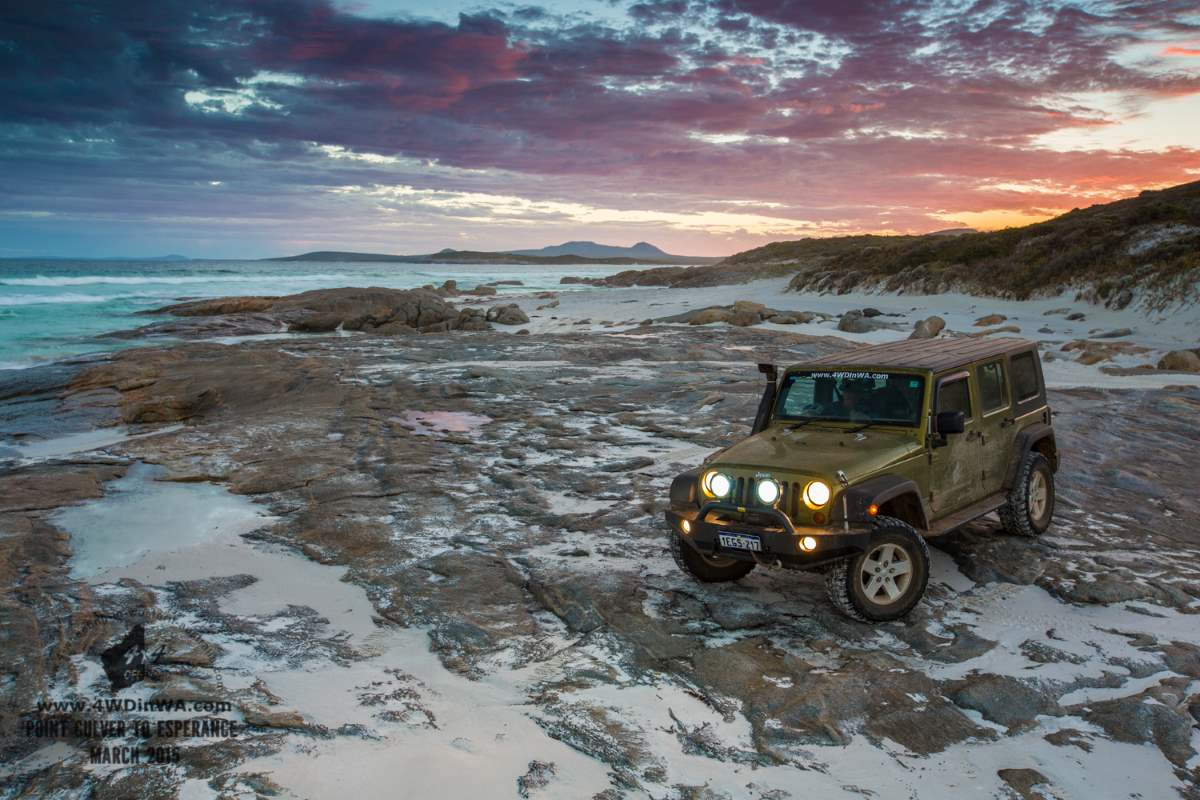 Jeep Wrangler JKU on the beach at night.