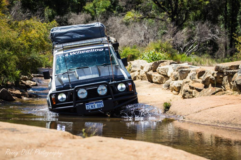 GQ Nissan Patrol in a water hole.