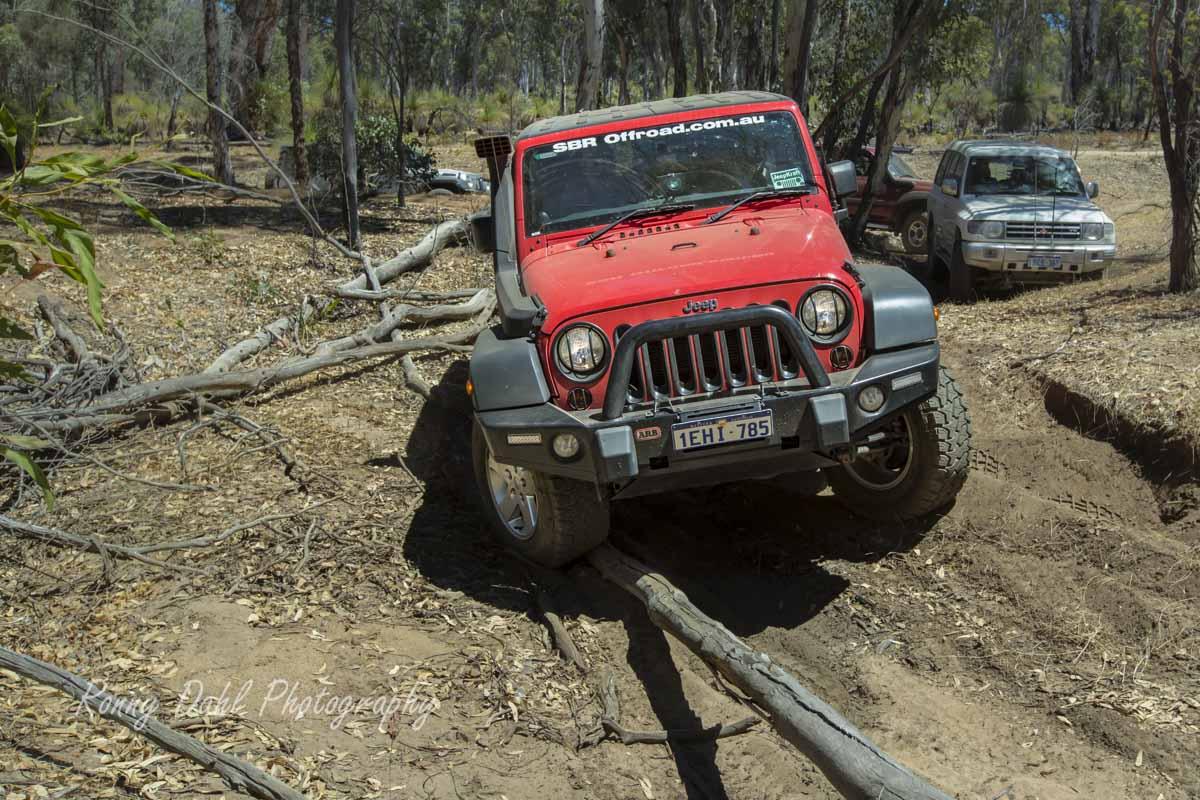 Red Jeep Wrangler.