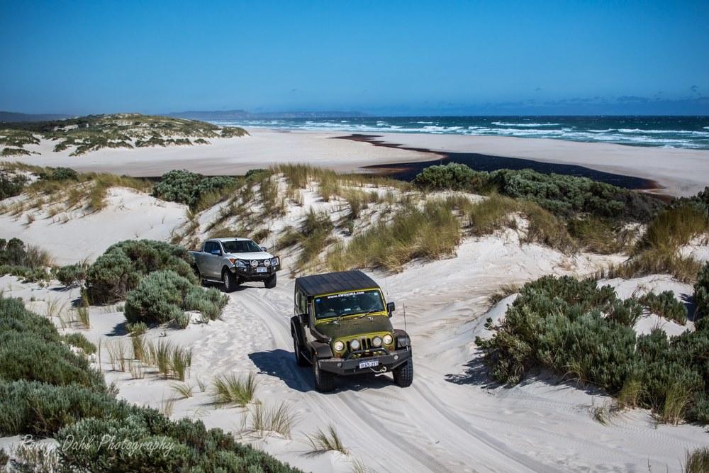 Jeep Wrangler on a sand track.