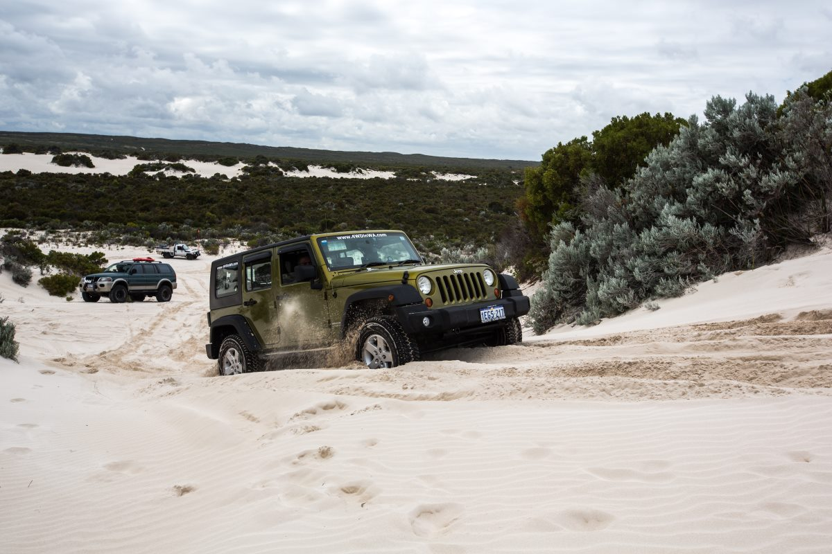 Jeep Wrangler in the sand dunes.