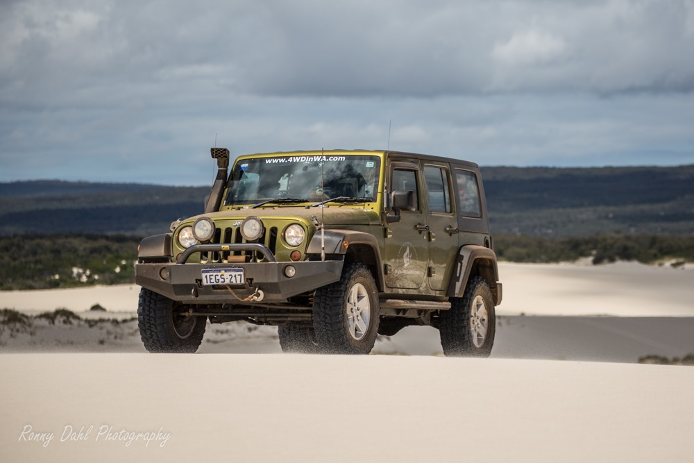 Jeep Wrangler in Yeagerup sand dunes, Western Australia.