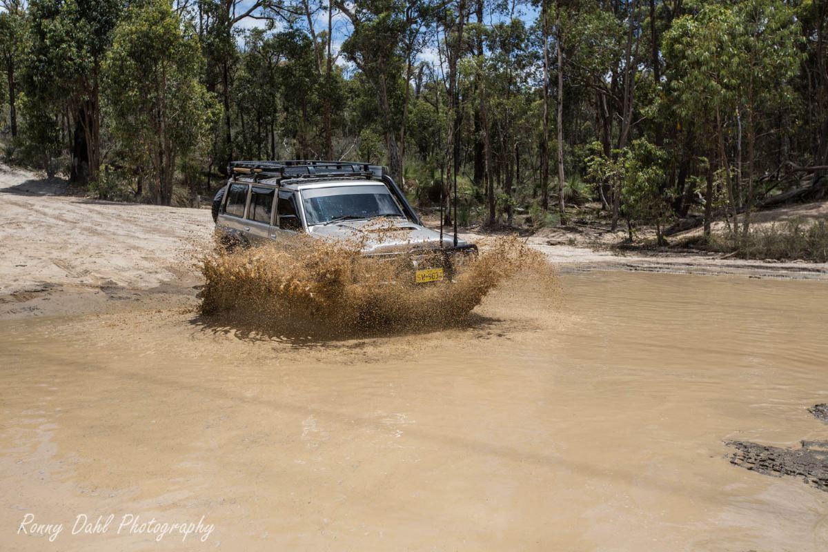 1993 Nissan GQ Patrol in mud.