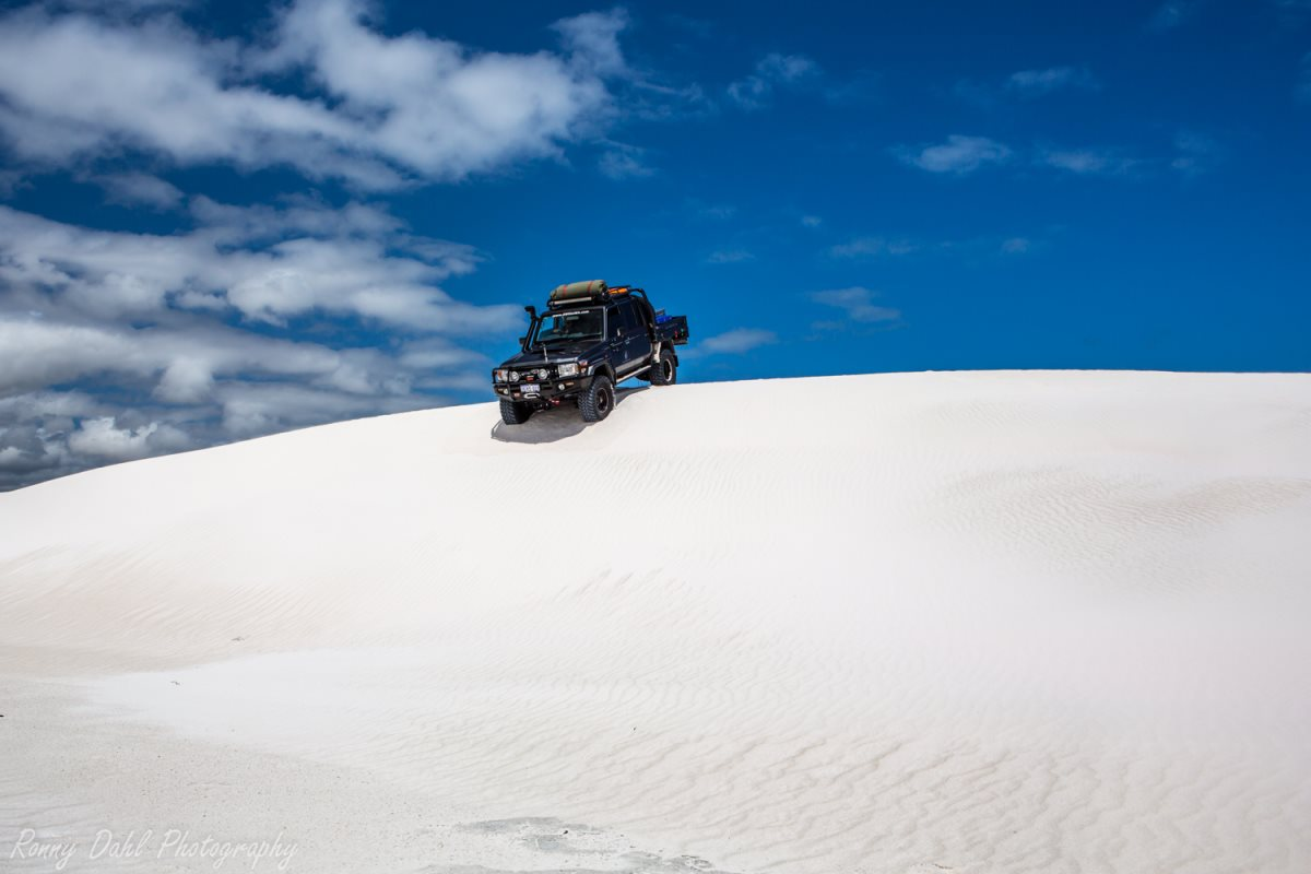 79 series Land Cruiser on a small dune.
