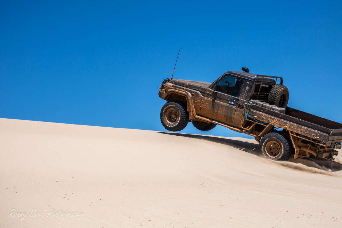 Land Cruiser playing in the sand dunes.