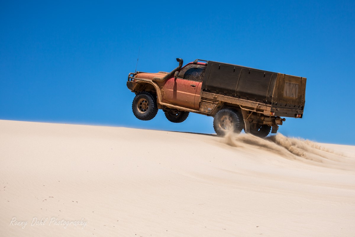 Nissan in the sand dunes.