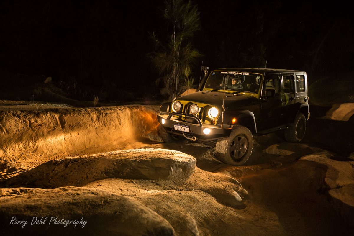 Jeep Wrangler 4 wheeling at night.