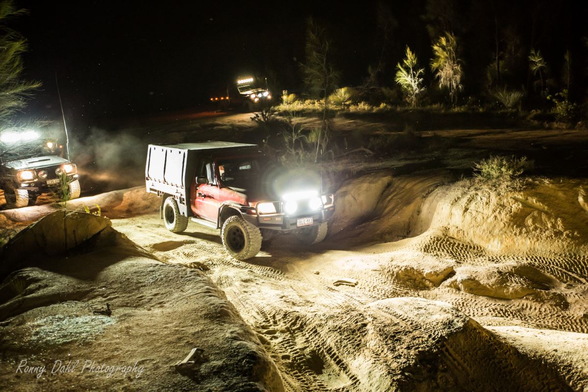 A Nissan Patrol in the dark on the Mundaring Powerline Track, Western Australia.