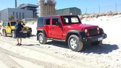 Red Jeep Wrangler Unlimited.