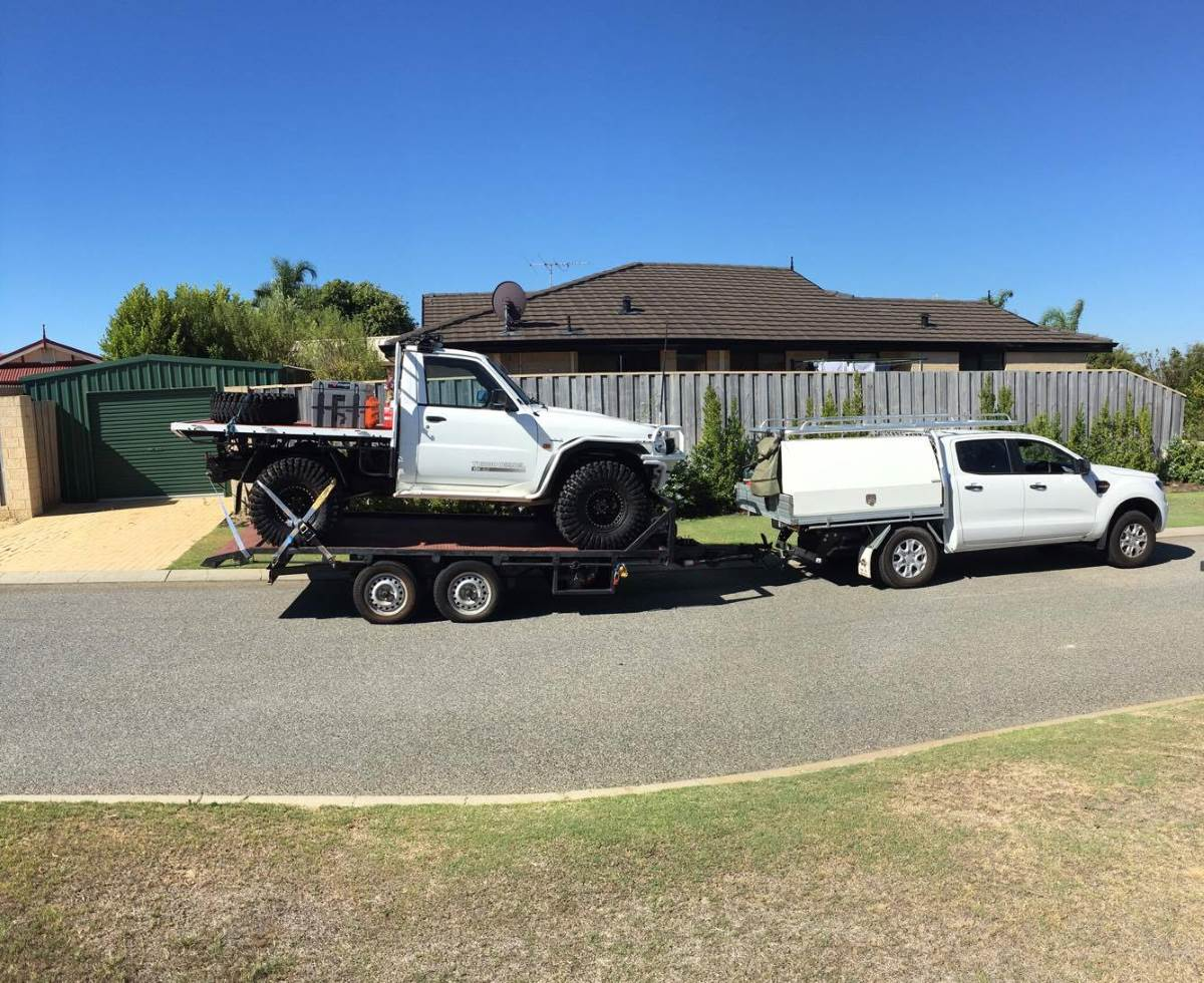 Nissan GU Patrol Ute on a trailer.